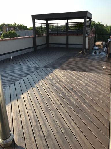 chicago rooftop deck with pergola staining